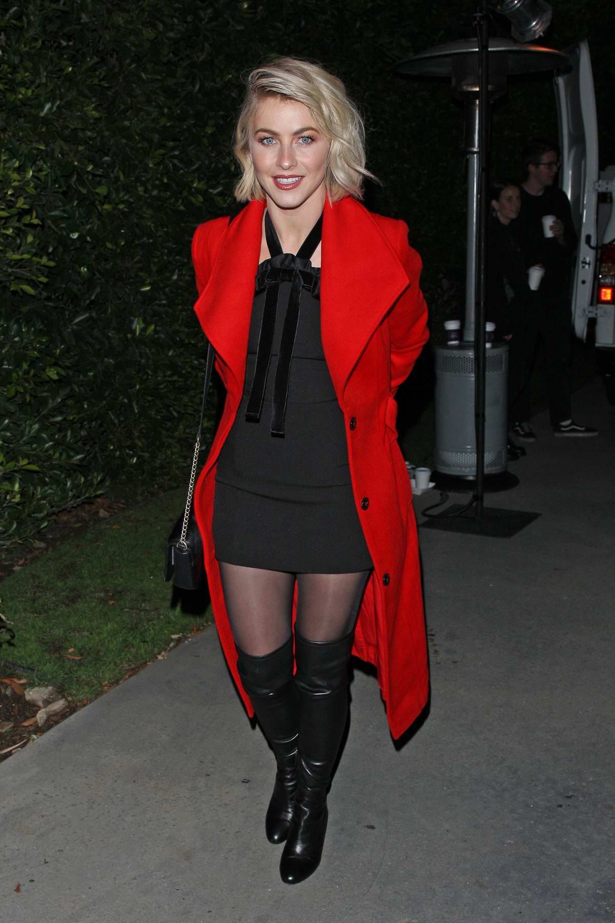 Julianne Hough seen wearing a bright red coat at Jennifer Klein's Holiday Party in Los Angeles