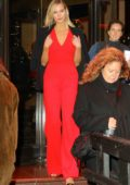 Karlie Kloss stands out in bright red dress as she leaves The Peninsula Hotel in New York City