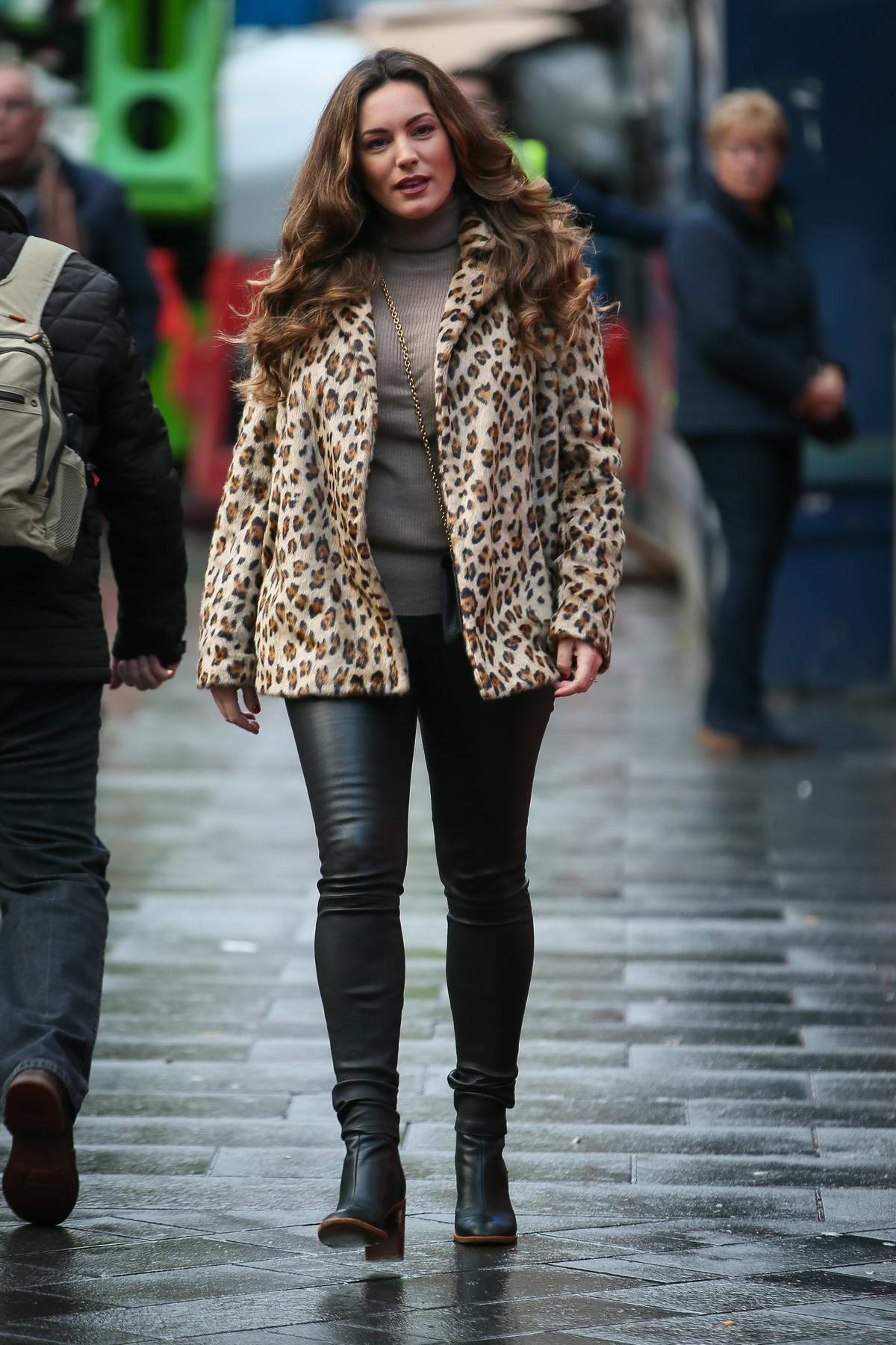 Kelly Brook wears leopard print jacket and black leather pants as she arrives at Global Radio studios in London, UK