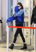 Kendall Jenner rocks an Adidas sweatshirt and leggings as she arrives to catch an early morning flight at LAX in Los Angeles