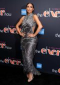 Kim Kardashian wears a metallic silver dress while attending 'The Cher Show' Broadway opening night with Kanye West in New York City