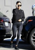 Kourtney Kardashian sports a black sweatshirt, leggings and matching Nike trainers while out to lunch in West Hollywood, Los Angeles
