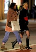Lily-Rose Depp wore a black puffer jacket, blue short skirt and boots while out shopping with a friend in SoHo, New York City