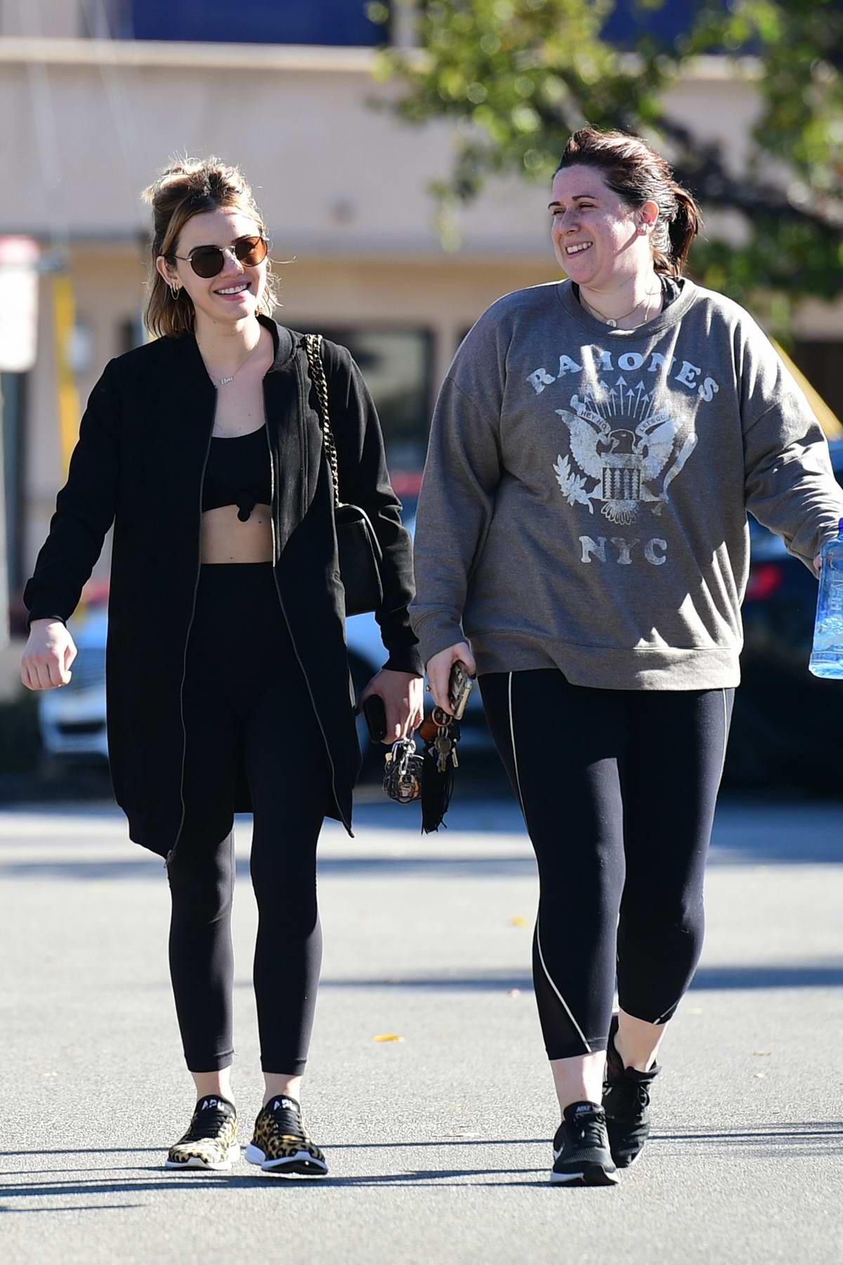 Lucy Hale leaves the gym with a friend after a workout session in Los Angeles