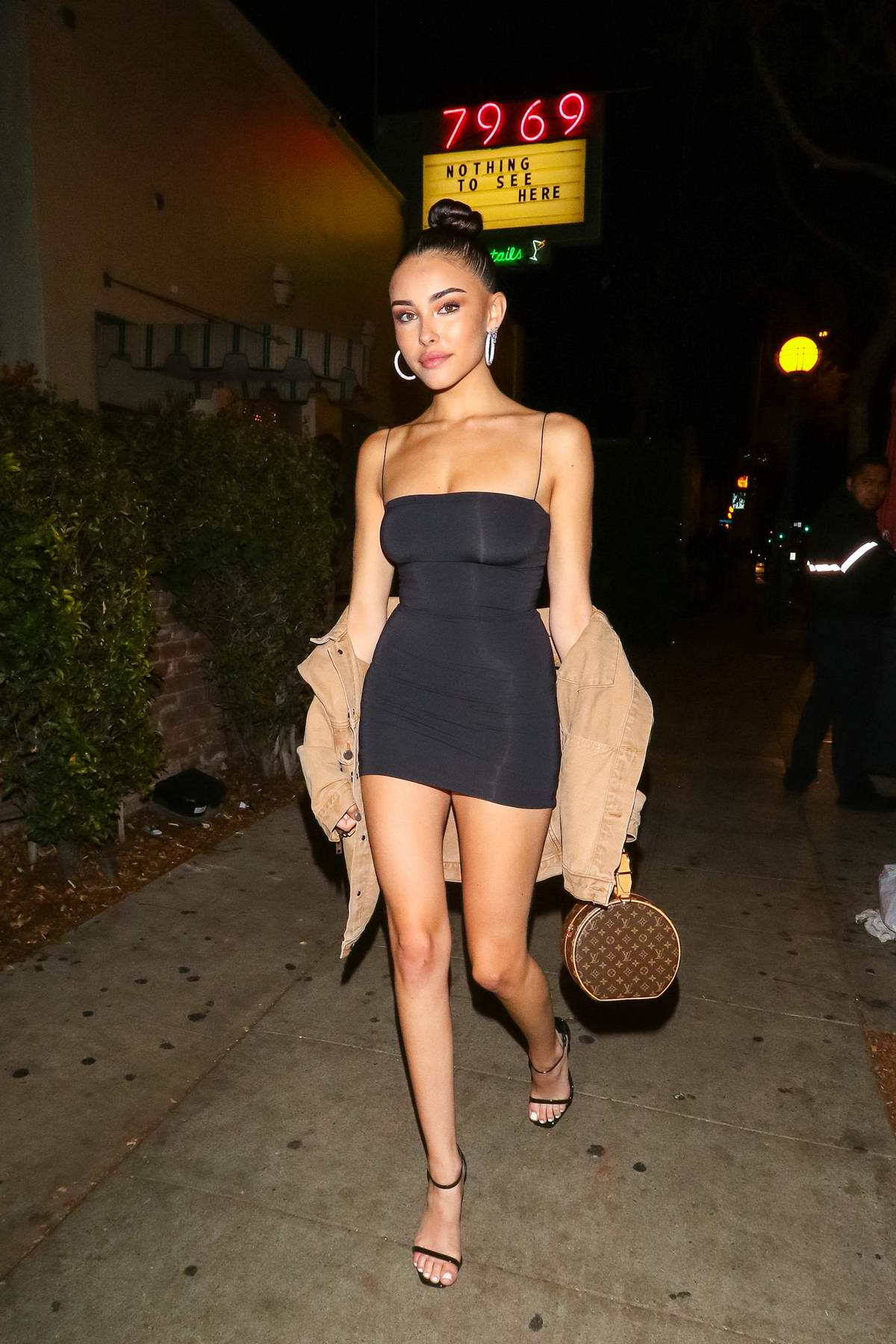 Madison Beer seen wearing a form-fitting black minidress during a night out at Delilah in West Hollywood, Los Angeles