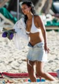 Maya Jama spotted in a white and red bikini as she enjoys another day on the beach in Barbados