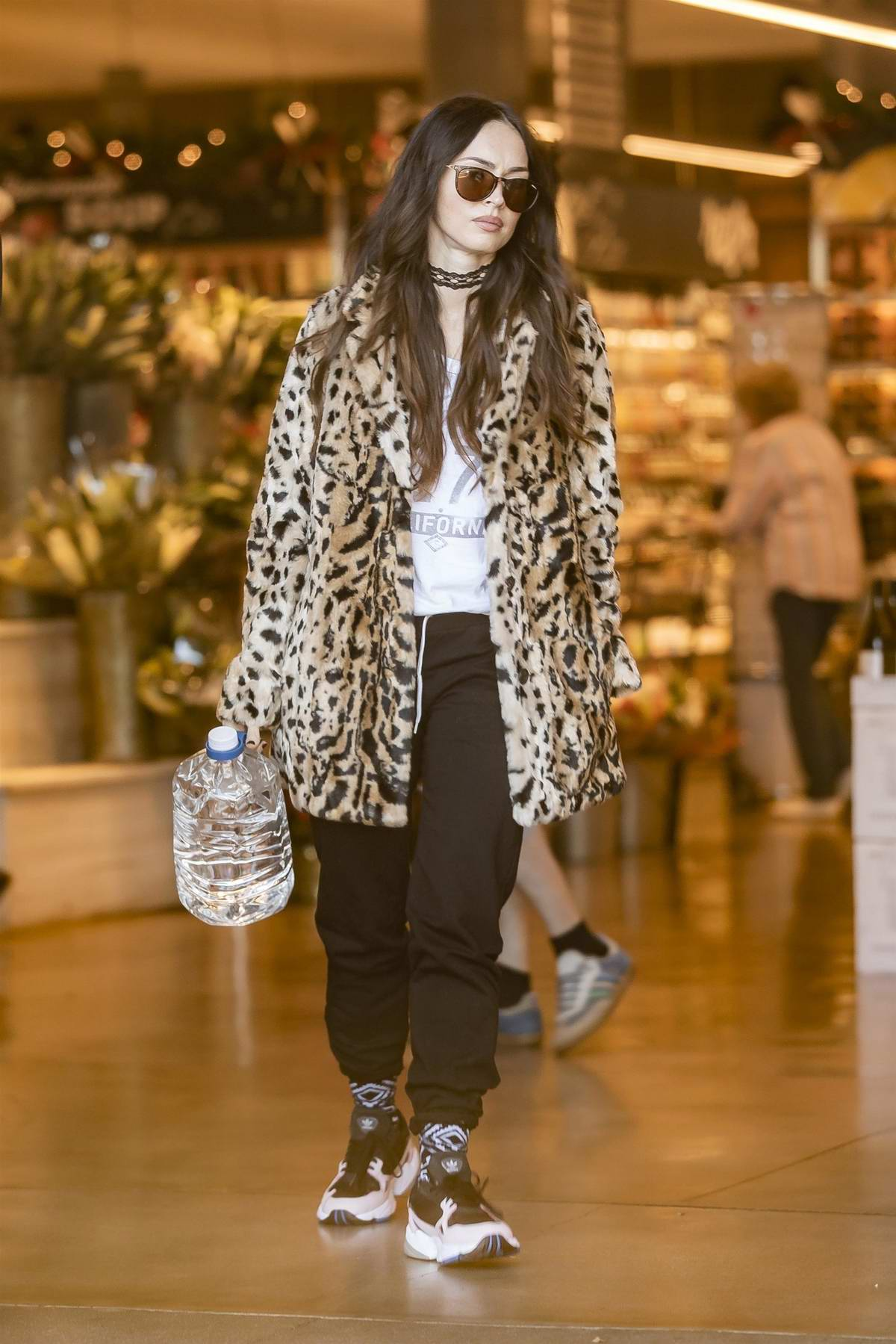 Megan Fox wore a leopard print coat as she stepped out with Brian Austin Green and their youngest son to pick up some groceries at Bristol Farms in Los Angeles