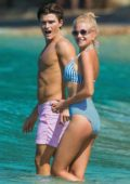 Pixie Lott wears a blue and white striped bikini while enjoying the beach with Oliver Cheshire in Bridgetown, Barbados