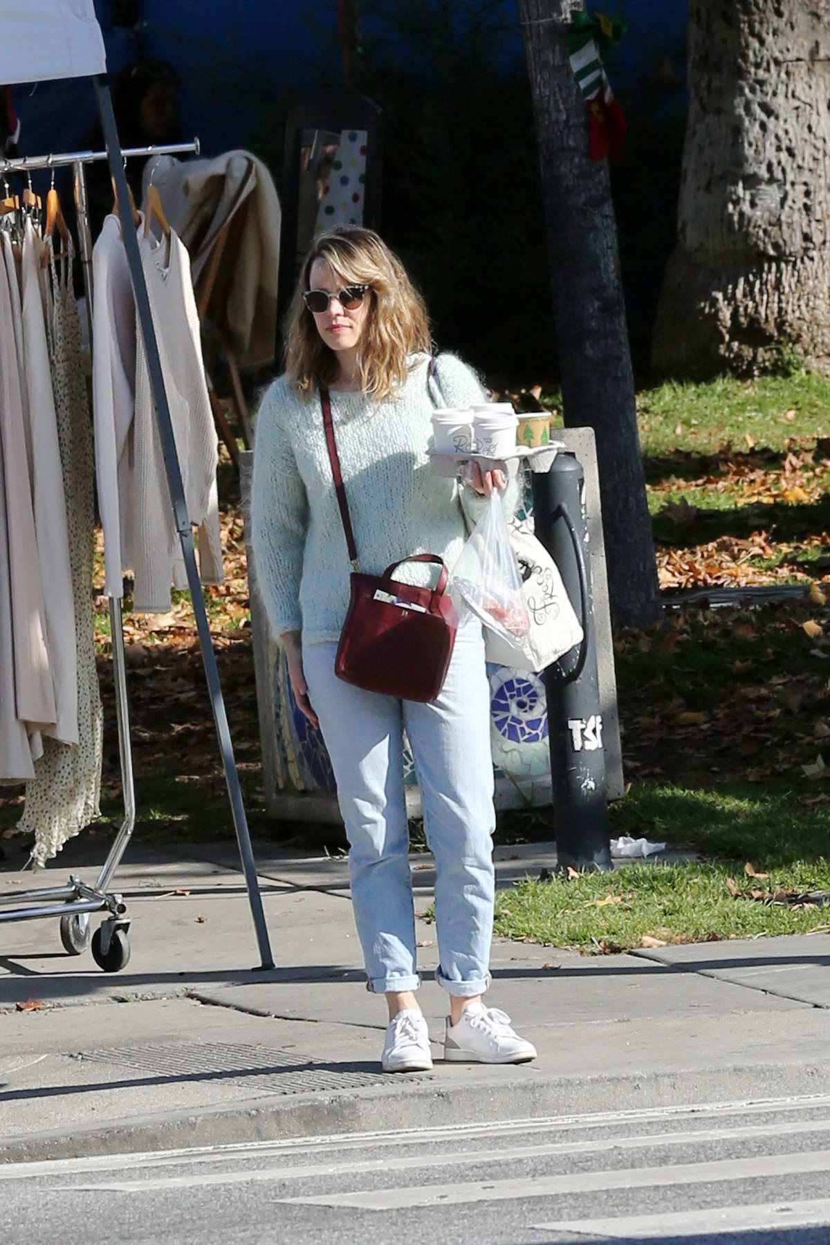 Rachel McAdams picks up some flowers and coffees while shopping at the flea market in Los Angeles
