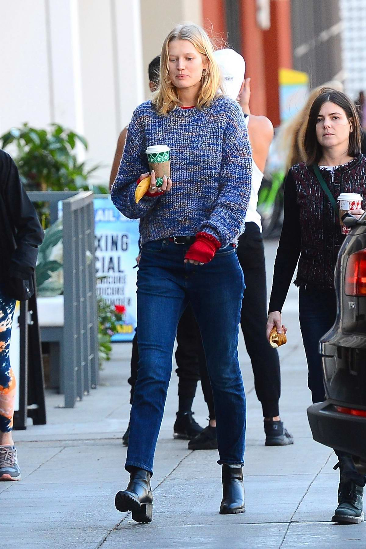 Toni Garrn keeps warm in a sweater and gloves while out for coffee with a friend in West Hollywood, Los Angeles