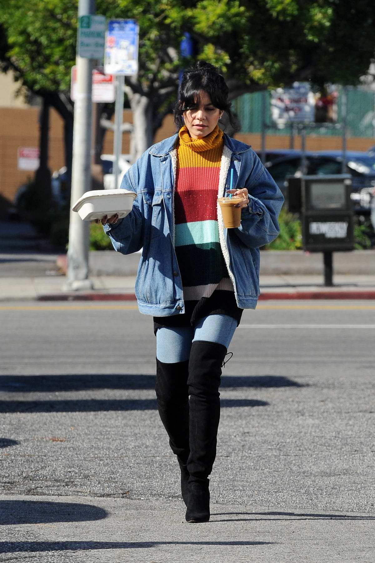 Vanessa Hudgens rocked a colorful striped sweater and thigh high boots while picking up coffee and snacks at Blue Bottle Coffee in Los Angeles