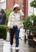 Alessandra Ambrosio braves the rain with a white puffer jacket while out for some shopping in Los Angeles
