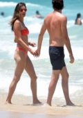 Alessandra Ambrosio hits the ocean in a red bikini during her vacation in Rio de Janeiro, Brazil