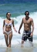 Alessandra Ambrosio rocks a white bikini as she goes for a swim with boyfriend Nicolo Oddi in Rio de Janeiro, Brazil