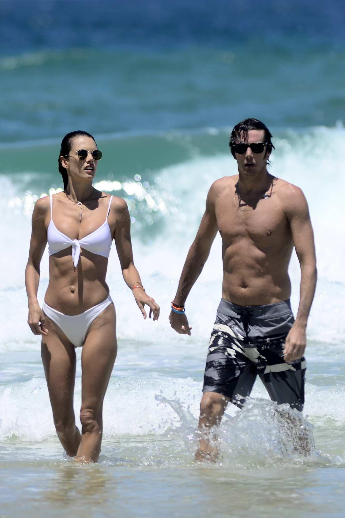 Alessandra Ambrosio rocks a white bikini as she goes for a swim with boyfriend Nicolo Oddi in Rio de Janeiro, Brazil