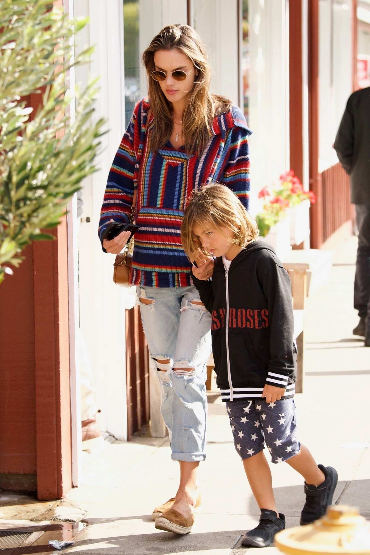 Alessandra Ambrosio seen wearing a colorful hoodie while out with her son in Los Angeles