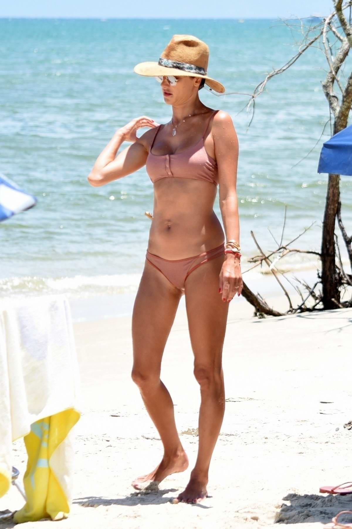 Alessandra Ambrosio sports a pink bikini as she enjoys another beach day in Santa Catarina, Brazil