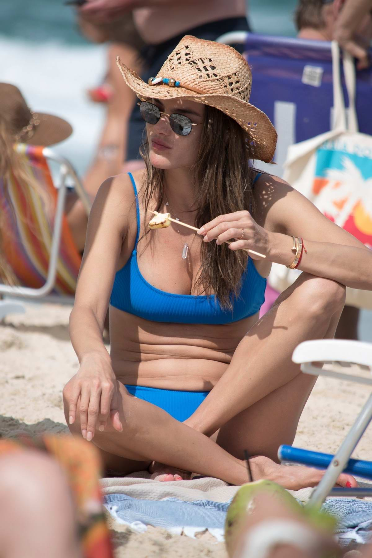 Alessandra Ambrosio spotted in a blue bikini while spending beach day with boyfriend Nicolo Oddi in Florianopolis, Brazil