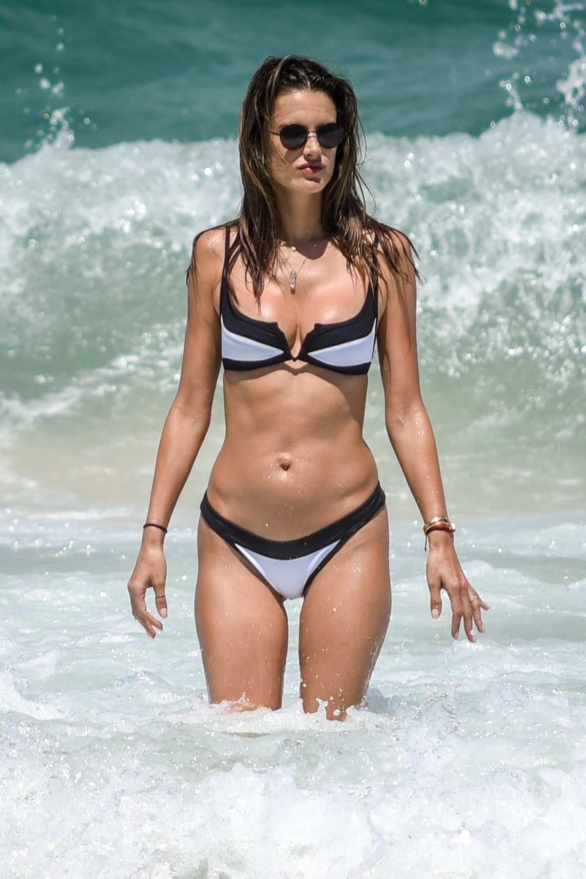Alessandra Ambrosio wears a black and white bikini while enjoying the beach with boyfriend Nicolo Oddi in Florianopolis, Brazil