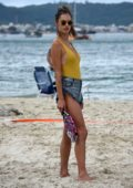 Alessandra Ambrosio wears a mustard yellow swimsuit while enjoying beach tennis with boyfriend Nicolo Oddi in Santa Catarina, Brazil