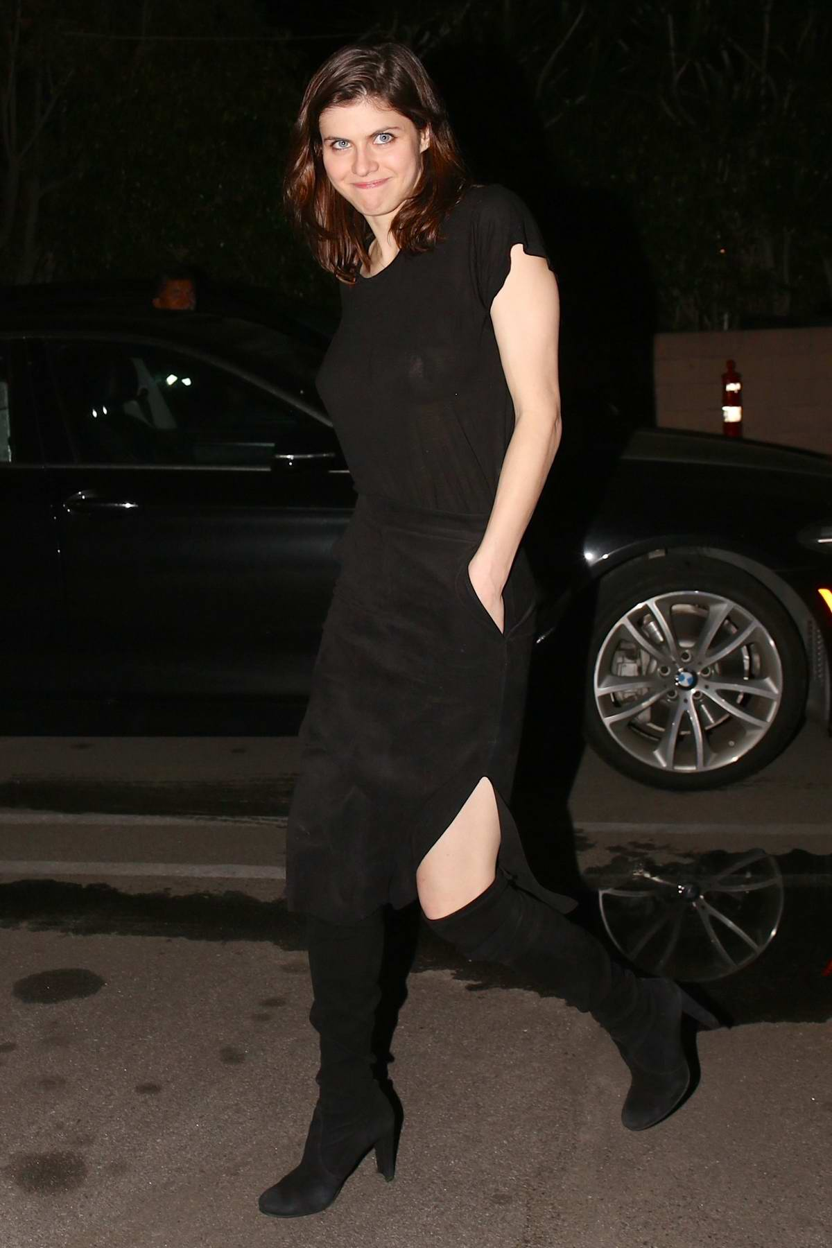 Alexandra Daddario wears a black dress while out for dinner with friends at Matsuhisa Sushi Restaurant in Beverly Hills, California