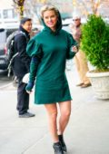 Alice Eve steps out in a hooded green dress in New York City