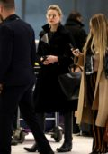Amber Heard looks stylish in all black ensemble as she arrives At CDG airport, Paris, France