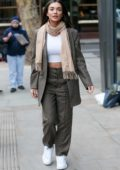 Amy Jackson shows off her toned abs in a white crop top with grey checkered pantsuit as she arrives AOL Build Series in London, UK