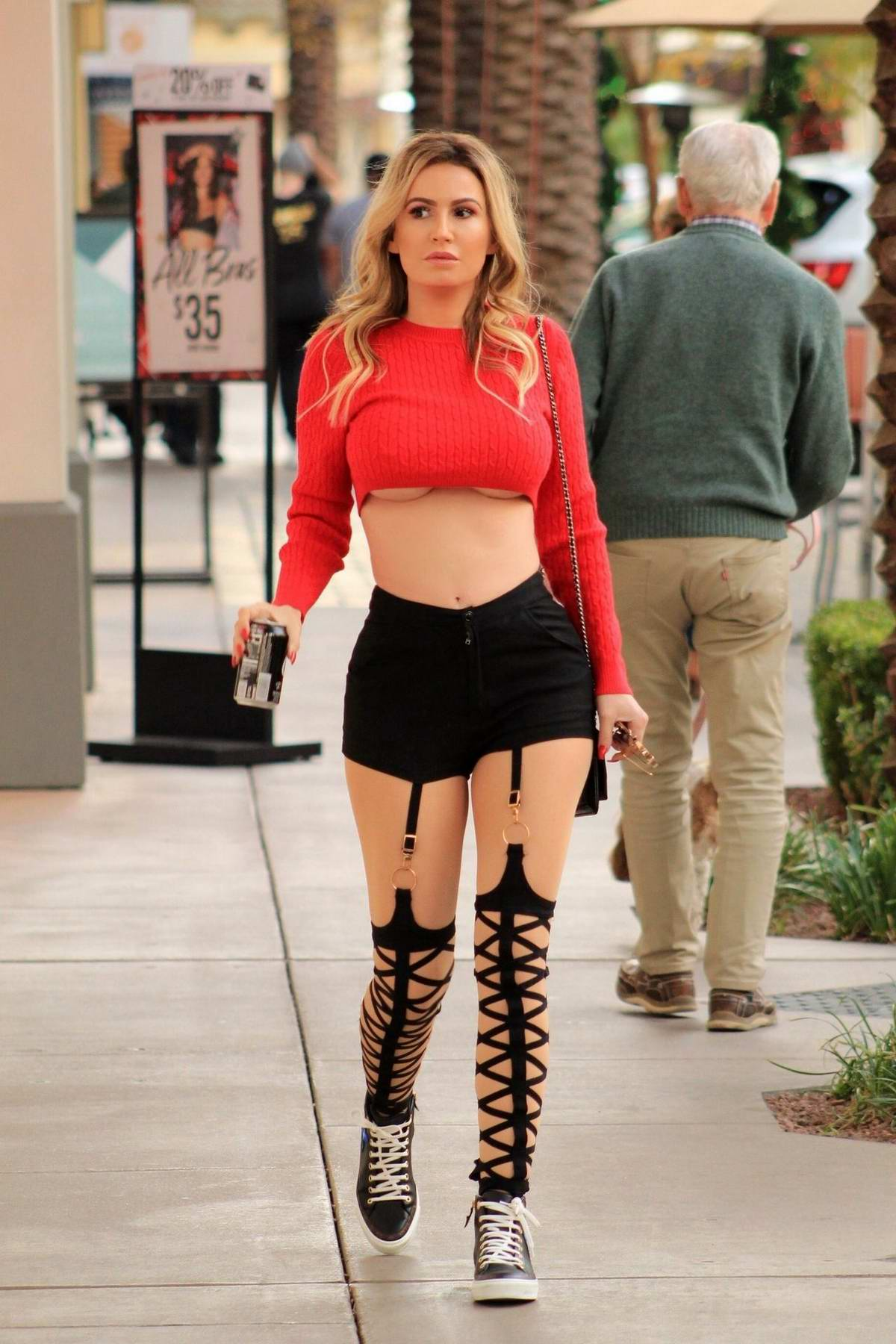 Ana Braga wore a red cropped top and black shorts during a shopping trip to a Victoria's Secret store in Los Angeles