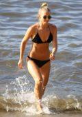 Anna Heinrich seen wearing a black bikini while enjoying the beach with Tim Robards in Sydney, Australia