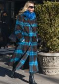 Annabelle Wallis keeps warm in a black and blue fur coat and blue scarf as she leaves The Bowery Hotel in New York City