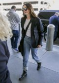 Anne Hathaway greets fans as she arrives to catch a flight at LAX airport in Los Angeles
