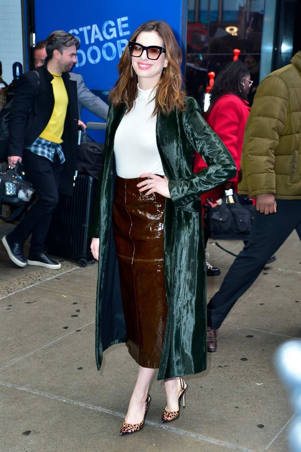 Anne Hathaway is all smiles as she leaves after her appearance on 'Good Morning America' in New York City