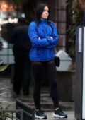 Ariel Winter seen waiting at the valet wearing a blue jacket and black leggings in Los Angeles