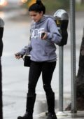 Ariel Winter wears a 'DOPE' hoodie as she runs errands in the rain in Los Angeles