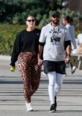 Ashley Graham and husband Justin Ervin hold hands while out for a romantic walk in Santa Monica, California