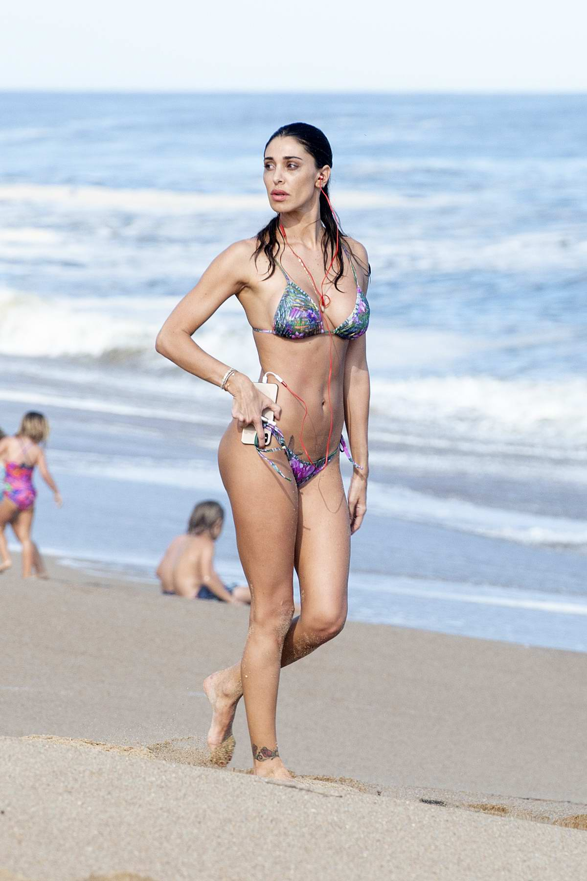 Belen Rodriguez shows off her beach body in a colorful print bikini during her vacation in Uruguay