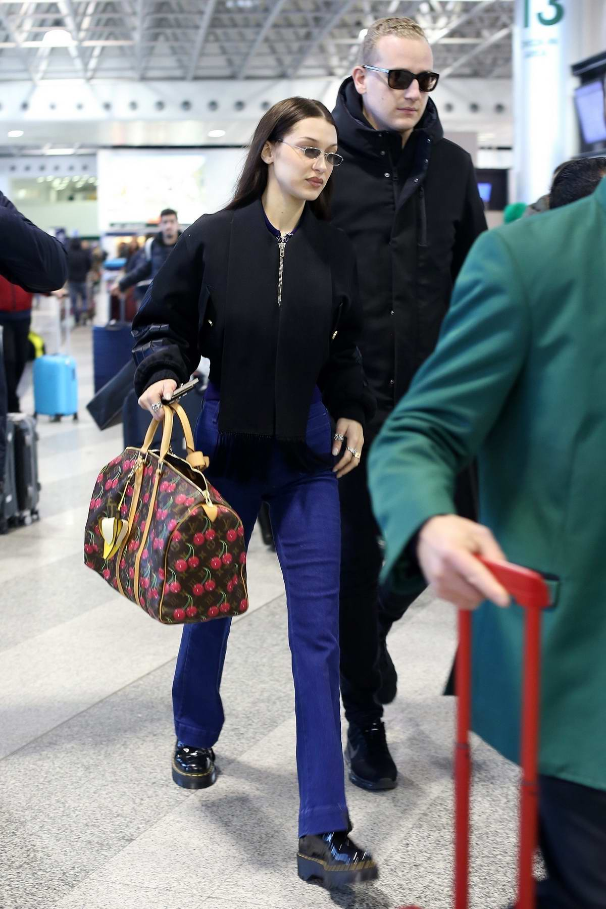 Bella Hadid arrives to catch a flight out of Malpensa Airport in Milan, Italy