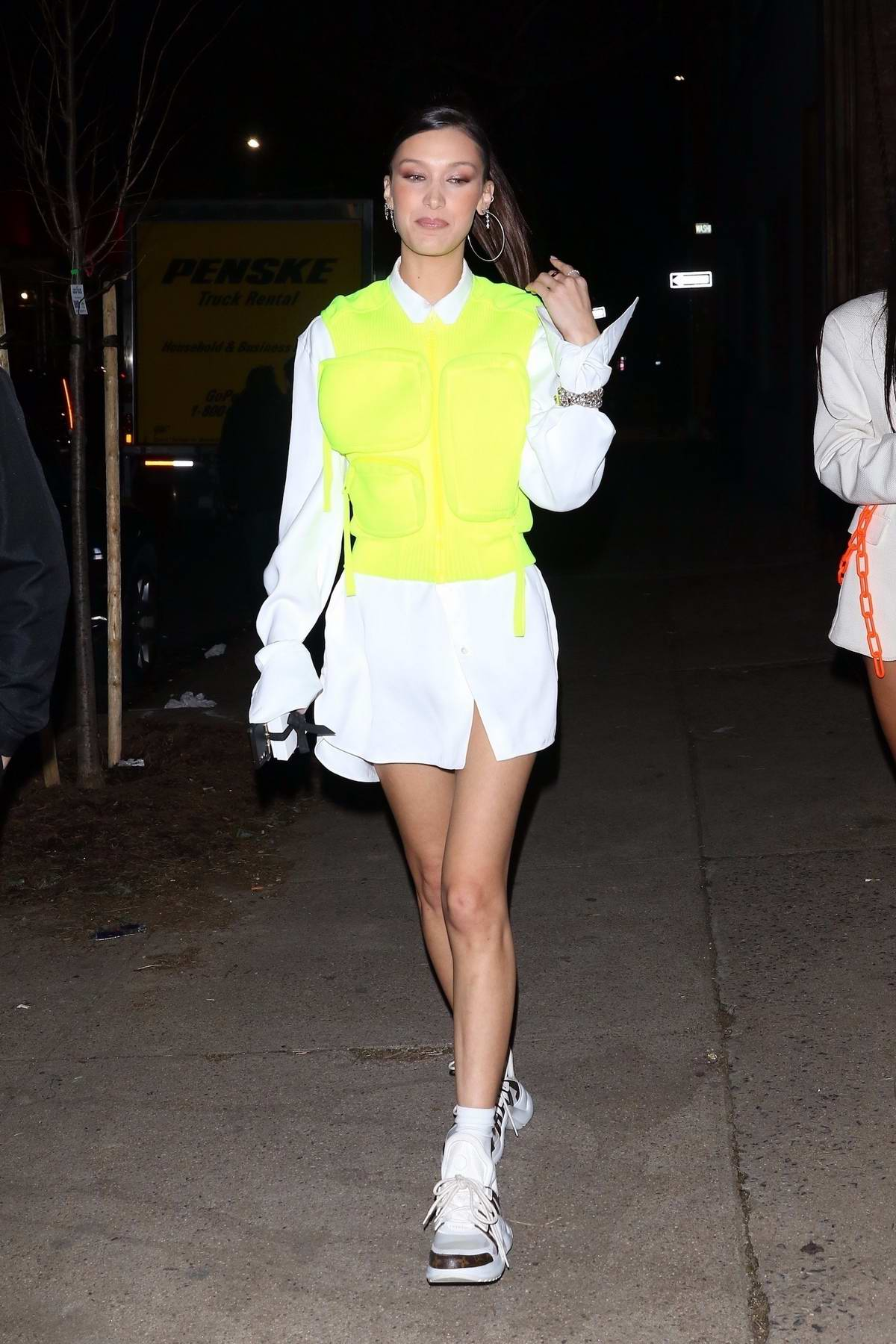 Bella Hadid rocks neon vest over a short white dress as she attends Chrome Hearts & Louis Vuitton Dinner in New York City