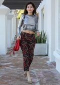 Blanca Blanco wears a silver cropped top and patterned pants while out in Los Angeles