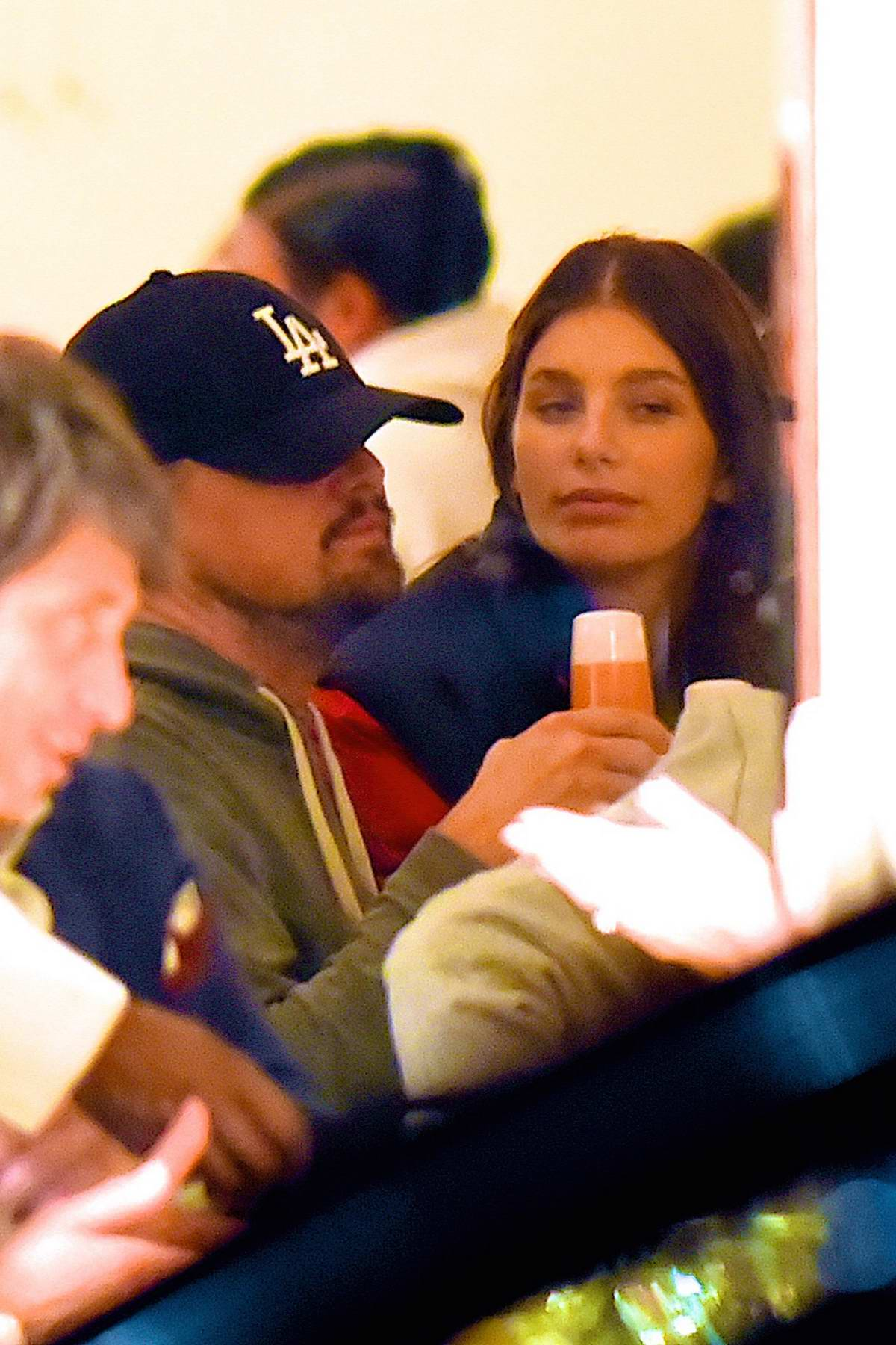 Camila Morrone and Leonardo DiCaprio share a kiss at a restaurant in Manhattan, New York City