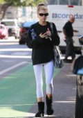 Charlotte McKinney seen wearing a black sweatshirt and white leggings as she leaves a yoga class in Santa Monica, Califronia