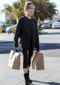 Charlotte McKinney wears all black while out shopping groceries after her workout session in Los Angeles