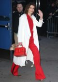 Cobie Smulders looks striking in a red outfit and white trench coat while visiting 'Good Morning America' in New York City