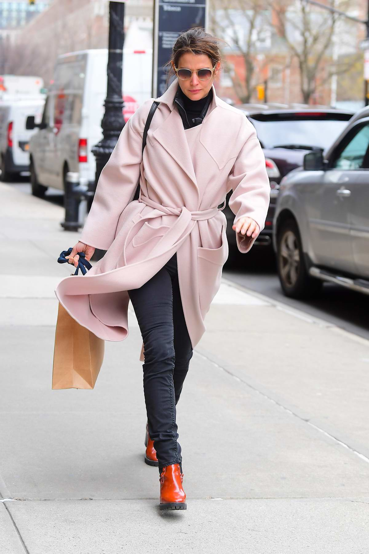Cobie Smulders wears a soft pink trench coat as she steps out for some shopping on a windy day in New York City