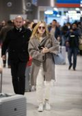 Dakota Fanning seen arriving at the CDG airport to attend the Paris Fashion Week in Paris, France