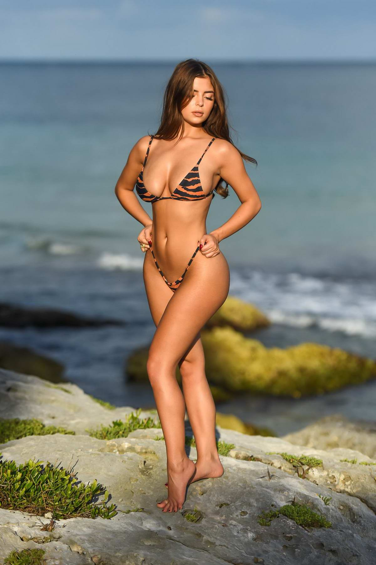 Demi Rose poses in an animal print bikini during photoshoot in Tulum, Mexico