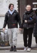 Diane Kruger and Norman Reedus holding hands while out for a stroll in New York City