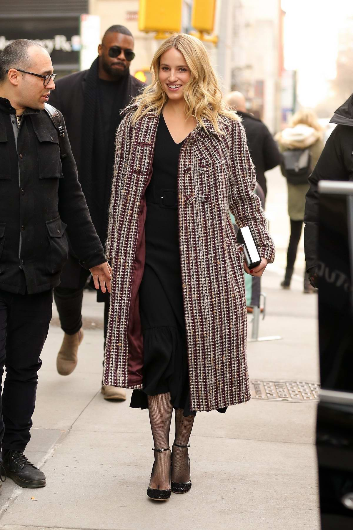 Dianna Agron is all smiles as she arrives at AOL Build Studio in New York City