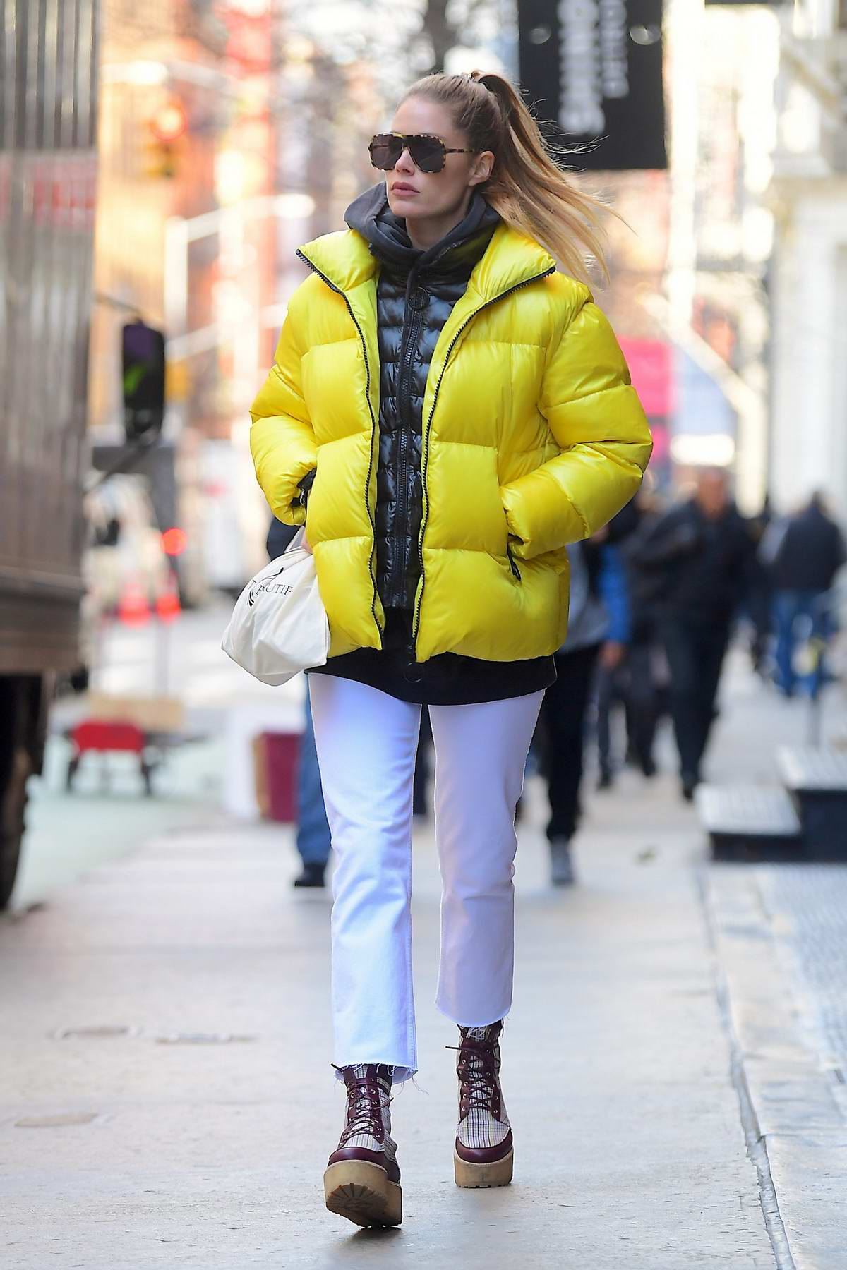 Doutzen Kroes wears a bright yellow puffer jacket while out in New York City